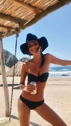 Emily Ratajkowski Brings Black To The Beach With Black Bandeau Bikini And Black Sun Hate