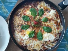 Baked Eggs and Sausage in a Rich Tomato Sauce