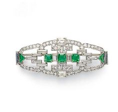 ART DECO EMERALD AND DIAMOND BROOCH, BY DREICER & CO.