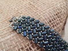 Check out this item in my Etsy shop https://www.etsy.com/listing/204333902/dark-blue-rulla-beaded-cuff-bracelet
