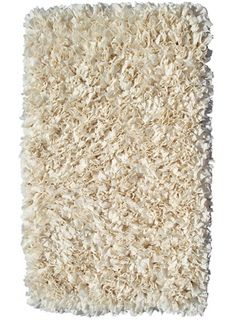 This adorable rug is constructed of 100% cotton.   Each individual rug is first hand dyed, then woven with strips of jersey