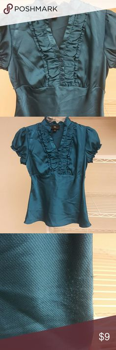 LAST CHANCE! Teal Ruffled Shirt! Donating Saturday 11/5!! Teal shining shirt! Used but may better in your closet! Minor pilling on bottom left. I will for sure iron the shirt for you before I ship it!! Feel free to ask questions or make a reasonable offer for single items  Reached my first 1000 followers last week :) **25% off bundles extended for the week!! All prices are already low and firm for bundles!  Please bundle to save! Iz Byer Tops Blouses