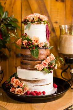 Semi naked chocolate vanilla wedding cake burgundy and coral