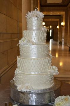 Tiered buttercream cake with gum paste flowers.