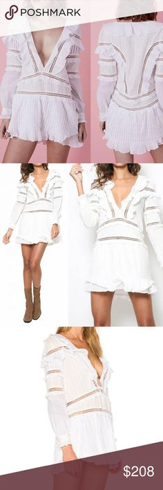 NWT For Love And Lemons White Mini Dress New with tag For Love and Lemons  Delicate and detailed. The Ziggy Dress features gentle ruffles mixed with tiny pleats for a soft angelic look. With a deep V-neckline and a cut that shows off your legs this dress pleases all of your sides.  Neckline hook and eye closure Pleated detail with ruffle trim White  Self: 100% Cotton Lining/Contrast: 100% Cotton Dry Clean Only For Love And Lemons Dresses Mini