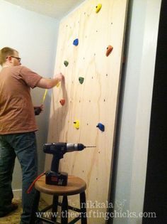 Parents-of-the-Year award to these guys for creating a climbing wall for their boys' playroom! Such a cool idea; though I have mixed feelings about having one in our home. =)