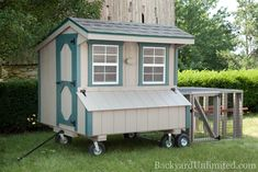Photo: 4'x6' Quaker Style Chicken Coop: includes 6 nesting boxes and holds 12-15 chickens. Shown with optional wheels and portable run