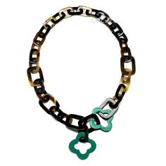 A beautiful chain necklace handmade from buffalo horn and lacquer. High polish finish. Lightweight. Actual colors may vary. 39.37 (100cm) length.