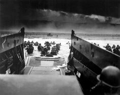 D-Day - American soldiers landing on the coast of France under heavy machine gun fire on June 6, 1944.