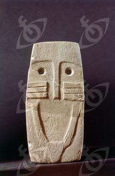 "A mother figure idol, the so-called ""eye idol"". Country of Origin: Iberia. Date/Period: Neolithic. Material Size: Aprox. 6 inches high. Credit Line: Werner Forman Archive/ National Archaeology Museum, Madrid"