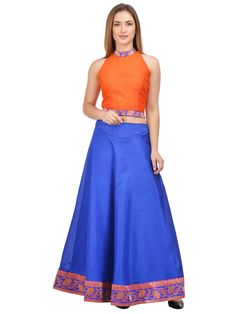 Add pizzazz to your look as you wear this Royal Blue Lehenga With Orange Crop top from the house of Castle. Made from Raw Silk, these Skit with Top will accentuate your look effortlessly. Club these with Orange top and step out in a casual yet classy look.