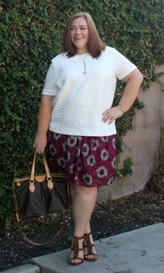 White quilted top with a marsala floral skirt and fringe pumps.