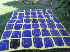 This Crown Royal bag quilt was fun and easy to make.  I split the bags  in half and cut the sides to get a straight line and uniform size.  To square off the bags, I made a triangle pattern to get a straight line.