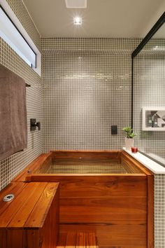 For people who love a relaxing hydrotherapy function from a water feature, a hot tub is definitely the best choice. Having a relaxing time while soaki. Spas, Zen Space, Interior Exterior, Home Look, Urban Design, Corner Bathtub, Ideal Home, Decoration, Tiny House
