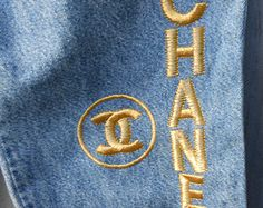 """1980s Jeans with """"Chanel"""" Letters and Symbol in Gold"""