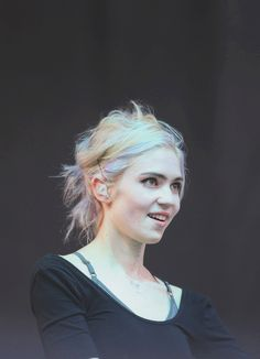 Grimes. Singer. Songwriter. Producer. Music video director.