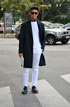 Perfect the smart casual look in a black overcoat and white chinos. Tap into some David Gandy dapperness and complete your look with black leather derby shoes.  Shop this look for $167:  http://lookastic.com/men/looks/baseball-cap-longsleeve-shirt-crew-neck-sweater-overcoat-watch-chinos-derby-shoes/5342  — Black and White Vertical Striped Baseball Cap  — Black and White Polka Dot Long Sleeve Shirt  — White Crew-neck Sweater  — Black Overcoat  — Silver Watch  — White Chinos  — Black Leather…