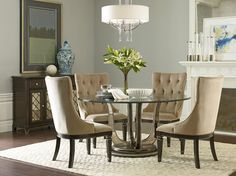 Affordable furniture meets long-lasting, contemporary design in American Drew's Belladonna dining room set. Featuring inset mirrored pieces in the table base and shimmery silver tipped accents on the chairs. #diningroom #americandrew