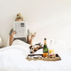breakfast in bed, a Sunday MUST. Just give me a bottle of champagne, a good read and my dog -- and I'm set! #AlcoveDigital