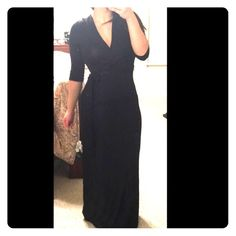 Black Jersey Maxi Wrap Style Dress I got these for my boutique but never got around to snapping pics in a photo shoot. It is not an actual wrap dress but it looks like one. Comes with a tie belt. I have sizes small and medium left. They run small so go up a size. Please let me know if you want to buy and which size so I can create a separate listing for you. Do not buy this listing please. DesertRoseCouture.com Dresses Maxi