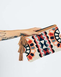 - Thick textured cotton clutch - Lined interior - Fringed zipper pull - Measurements: W x H RESPONSIBILITY Cleobella's handmade process allows us the pleasure of personally working with lo Embroidery Bags, Embroidery Patterns, Macrame Colar, Punch Needle Patterns, Fabric Bags, Printed Bags, Crochet Motif, Rug Hooking, Creations