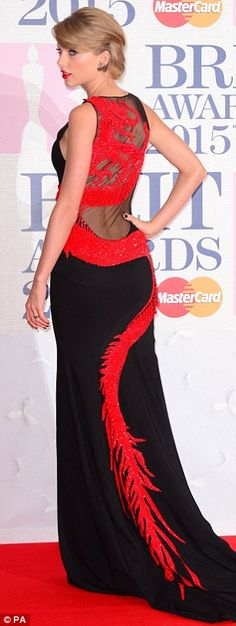 Unleashing the her inner dragon! Taylor Swift was spotted arriving at the BRIT Awards in a...