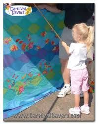 Fishing booth DIY. Cute for church carnival. Easy just grab small prizes and candy.