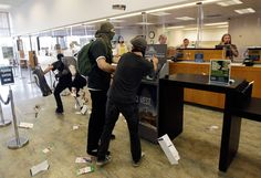 Demonstrators vandalize a Bank of the West branch during May Day protests on May 1, 2012 in Oakland, California.