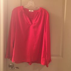 A red long sleeve sheer top! Red size large only worn twice. Too big for me now. Great condition like new. Long sleeve. Gaudy me  Tops Blouses