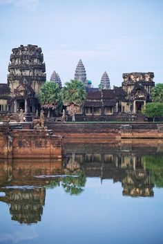 .~Nestled between rice paddies and stretched along the Siem Reap River, the small provincial town of Siem Reap serves as the gateway to the ancient temple ruins of the Khmer Empire~. /adeleburgess/