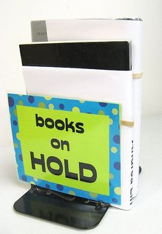 Books on hold. Laminate signage to place over bookends. Also, Renewals sign.  Photo idea only, no link.