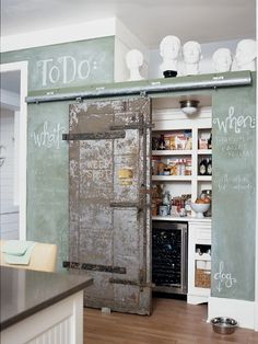 A green chalkboard wall and an internal barn door give this kitchen a … – Own Kitchen Pantry Kitchen Inspirations, Sweet Home, Pantry Design, House Interior, Kitchen Design, Cool Kitchens, Cottage Living, Kitchen Pantry Design, Home Decor