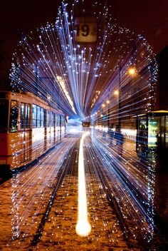 Long exposure of a departing Tram in Budapest covered in 30,000 LED lights.