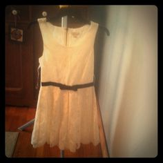 Beautiful lace dress! Forever 21 beautiful lace dress, size small. White flower pattern lace with a black belt. I bought this off another posher but unfortunately, this is a bit too snug. I'd say this would best fit a size 0-2, I'm typically a 4. Forever 21 Dresses