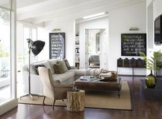 Neutrals. Jute rug. Accent chair. Wooden stump side table. Espresso brown leather ottoman as coffee table.