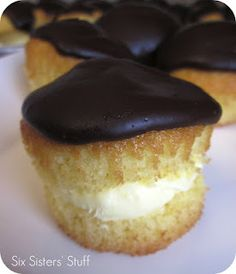 Boston Cream Pie Cupcakes Recipe | 24 cake-mix yellow cupcakes, cooled and unwrapped (I used a butter golden mix)    1 (3.4 oz) box French Vanilla instant pudding  1 1/2 cups heavy whipping cream  1/2 cup powdered sugar  1/4 cup milk  1/2 cup sour cream