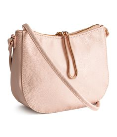 Small powder pink shoulder bag with grained faux leather and decorative gold snake chain. | H&M Pastels