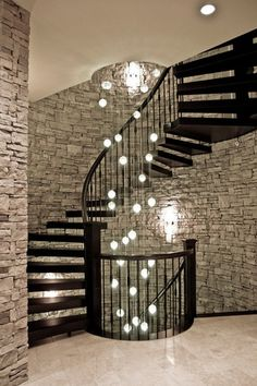 Contemporary Staircase with Eight lamp ceiling with beautiful long strands of clear crystal balls., can lights, High ceiling