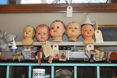 Doll heads - Assemblage Studio again.  http://www.theassemblagestudio.com/about.html#