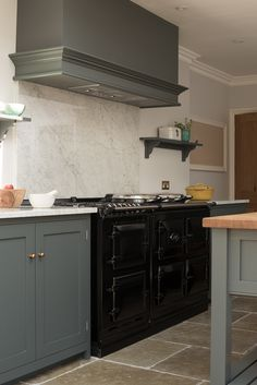 A lovely black AGA in deVOL's The Hampton Court Kitchen. It looks great against…