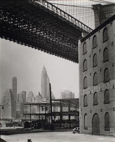 The View of Manhattan from under the Brooklyn Bridge, 1936. Photo from the New York Public Library.