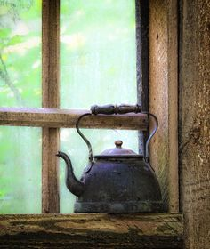 well, this is old kettle in the window~~~~true country   `````check out wooden handle on bail....very old...'30s or earlier.....