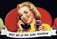 In this photo soda-jerk Margie Chrisman poses while sipping a fountain Coke and waiting for the after-school crush.