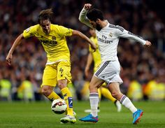 Isco of Real Madrid competes for the ball against Tomás Pina of Villarreal during the La Liga match between Real Madrid and Villarreal at Estadio Santiago Bernabeu on March 1, 2015 in Madrid, Spain.