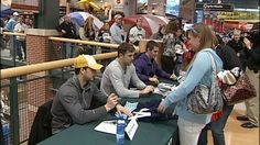 Pascal Dupuis and Mark Letestu, were at Dick's Sporting Goods in Robinson Township, signing autographs for fans.