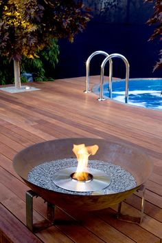 Fire pit, raised deck, hot tub.