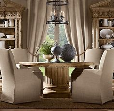 this is the table I want in our kitchen . . . no bumping feet on pedstal (restoration hardware)