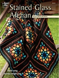 "Get the look of stained glass in this afghan crochet pattern.Create a stunning effect with this beautiful stained glass afghan made using worsted weight yarn. Finished size is approximately 45"" x 60"".Skill Level: Intermediate to Experienced"