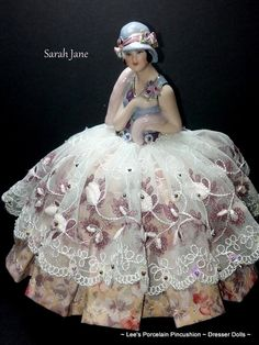 Sarah Jane is a stunning reproduction Porcelain Half Doll Pincushion ~ Dresser Doll. She is OOAK and is signed and dated on the base.    She