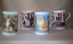 """Made in Staffordshire, England. Fine Bone China. Great gift for the cat lover. Each cup measures 4"""" tall & 3"""" in diameter."""